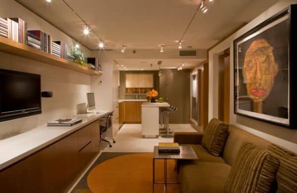 Warm-and-relaxing-living-room-employs-track-lighting-for-lovely-ambience