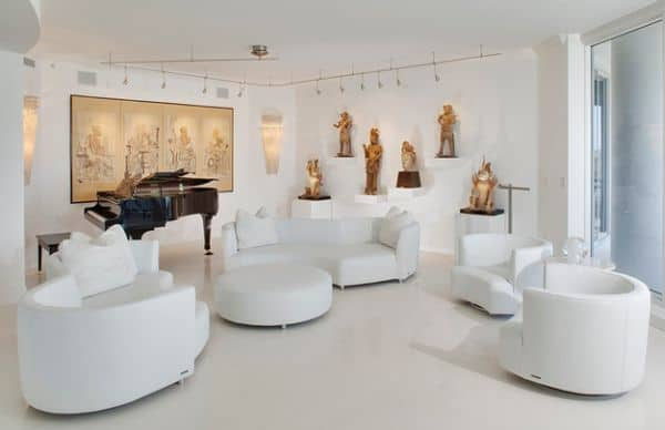 White-contemporary-setting-with-track-lighting-that-brings-in-a-museum-feel