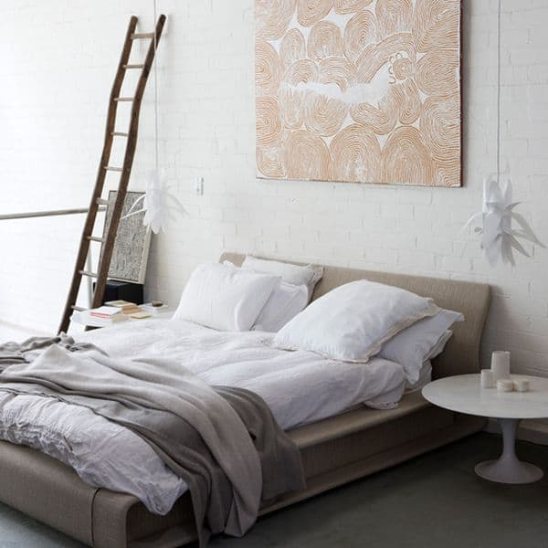 impeccable modern bedroom with a brick in white