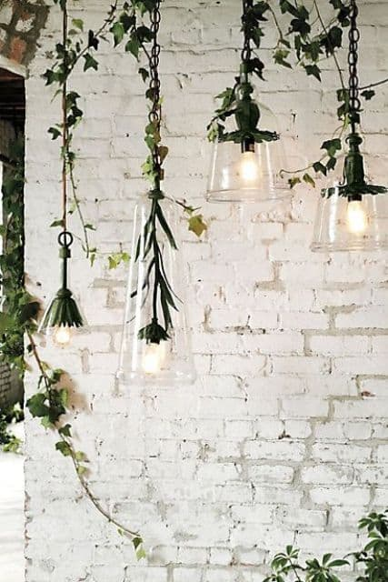 brick white wall with greenery and light