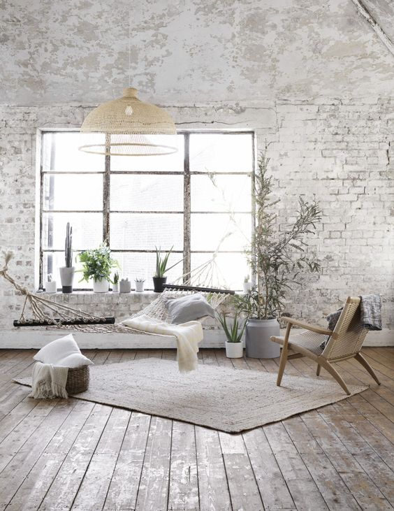 white wall and bricks exposed in a splendid bohemian decor
