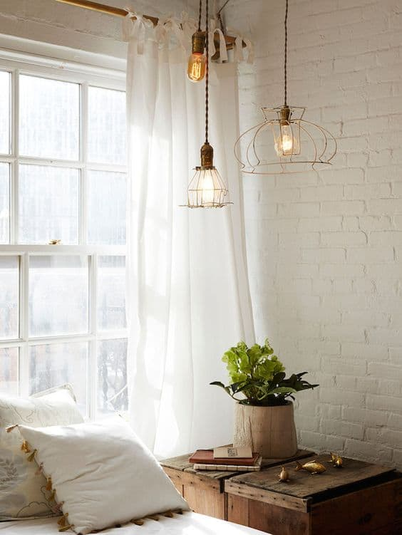 rustic industrial bedroom featuring white bricks