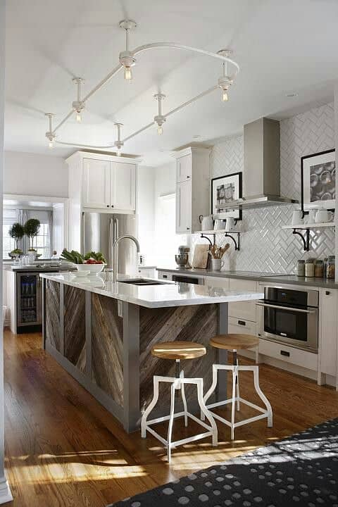 87 exceptionally inspiring track lighting ideas to pursue a closed circuit track light system above the kitchen isle can beautifully integrate form with function aloadofball Image collections
