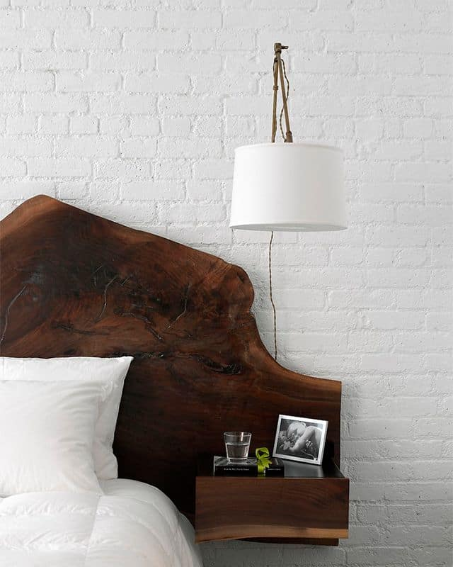 wooden headboard doubled by white bricks on the wall