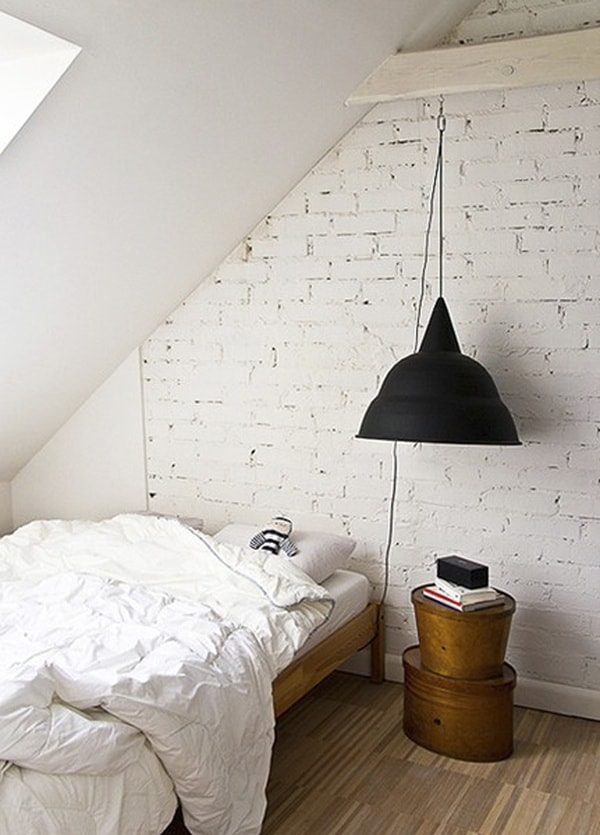 small attic bedroom with white bricks