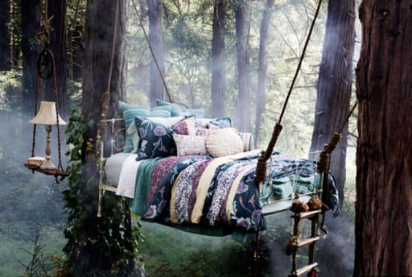 romantic hanging bed in thw woods