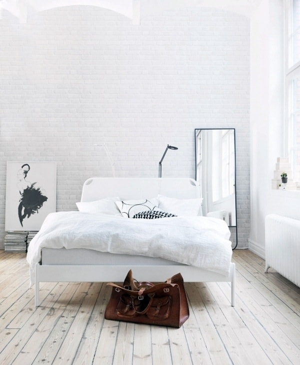 stark white interior with light and white bricked walls