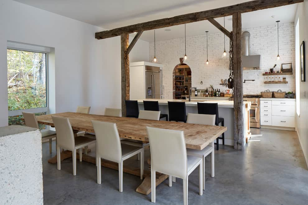 Modern Rustic Dinning Room Adjacent To White Brick Walled Kitchen