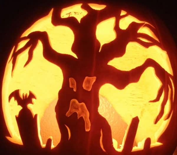 20. SPOOKY TREE PUMPKIN CARVING MAKING A SCENE