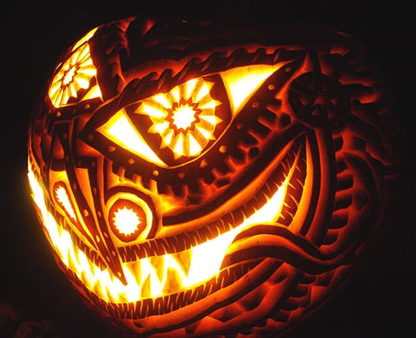 9. INTRICATE EVIL PUMPKIN CARVING SMILING