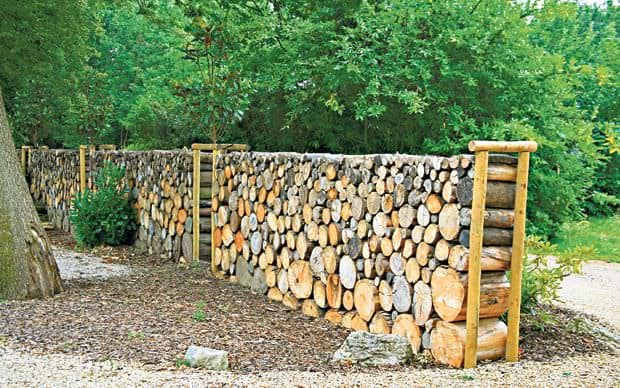 28. WOODEN LOG FENCE