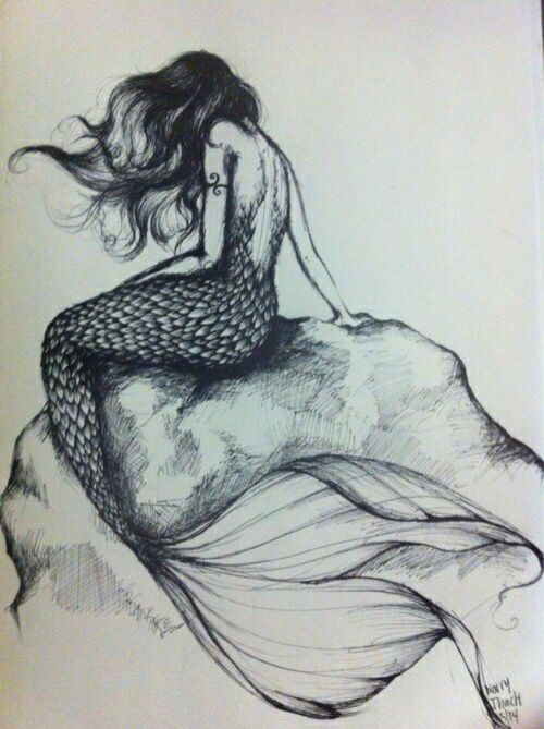 MERMAID RESTING ON A ROCK