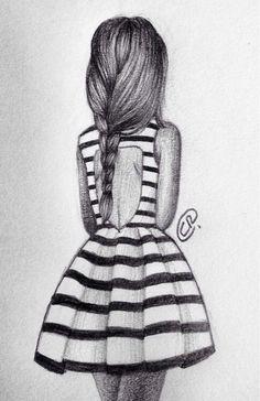 teenage girl in a skirt wearing dress looking into the distance