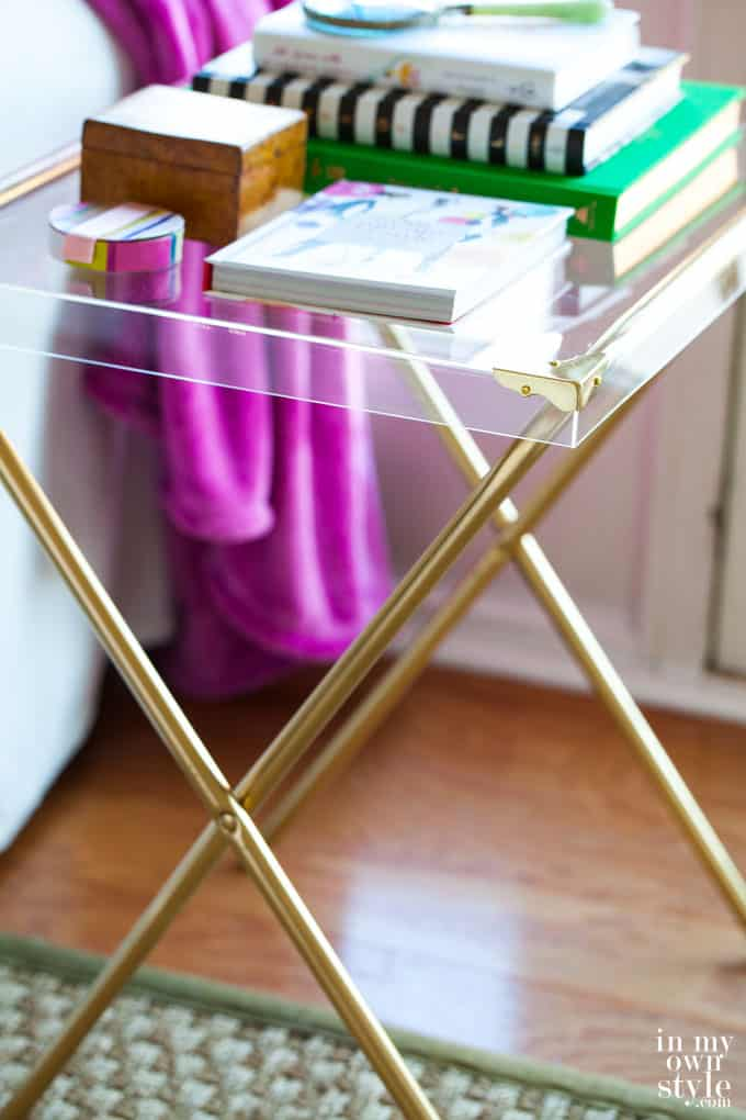 32. ACRYLIC SIDE TABLE WITH X SHAPED METAL LEGS