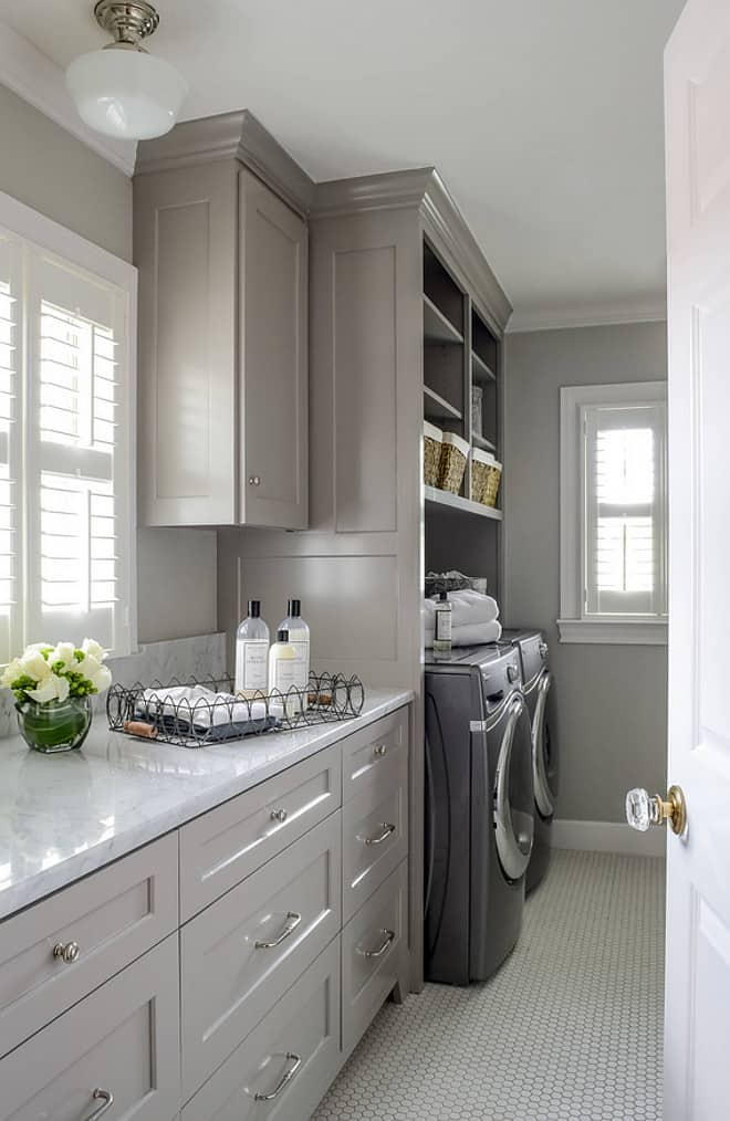 Laundry room. Front loading washer dryer storage baskets for laundry detergent large deep drawers for sorting clothes.