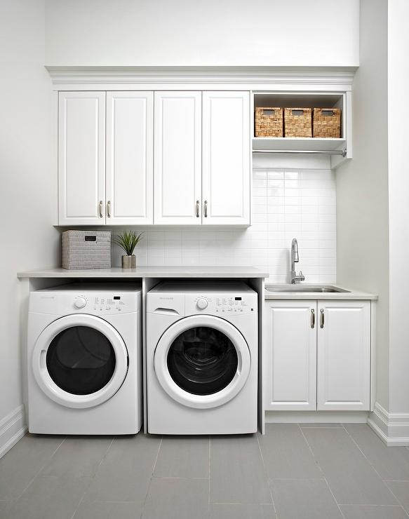 white modern laundry room clothes rod gray staggered floor tiles