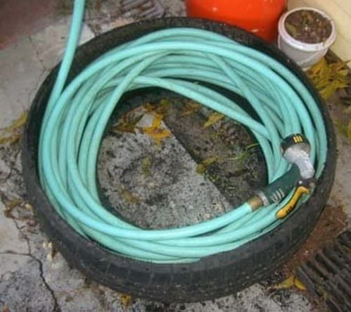 Instead Of LEAving The Garden Hose Out Where It Can Be Damaged, Store It In  A Tire