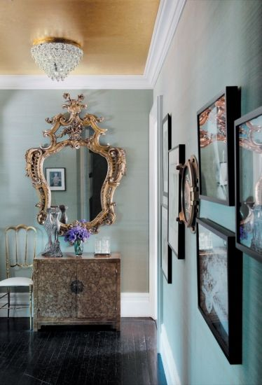 teal walls with golden coved ceilings