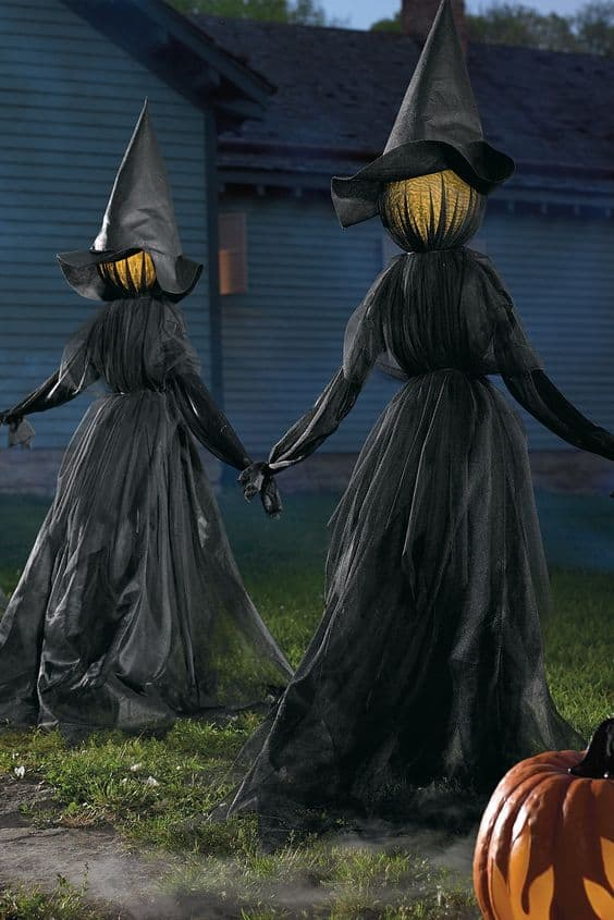 128. WITCHES HOLDING HANDS