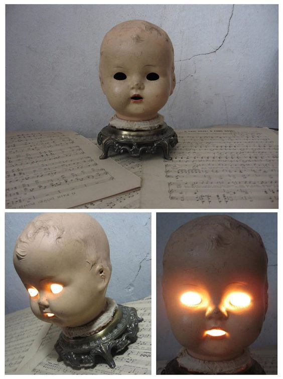 56. CREEPY DOLL HEAD WITH GLOWING EYES