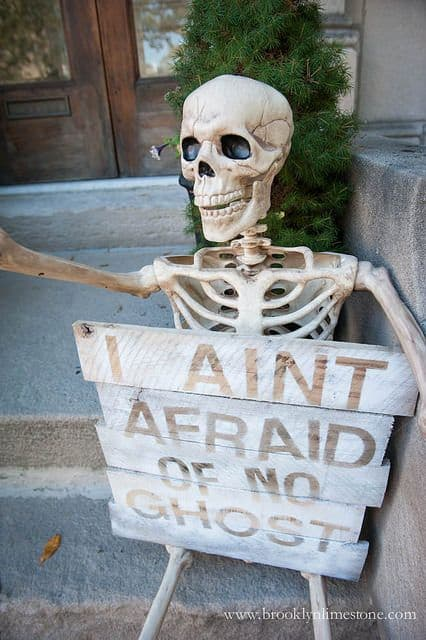 122. SKELETON HOLDING A SIGN