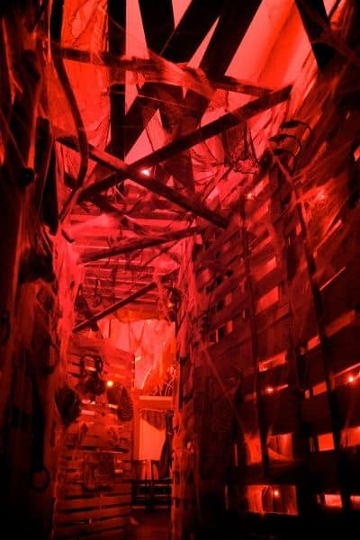 57. HORRIFYING INDOOR WALKWAY WITH DRAMATIC RED LIGHTING