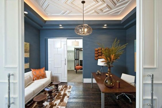 lighted coved ceilings in white on blue walls
