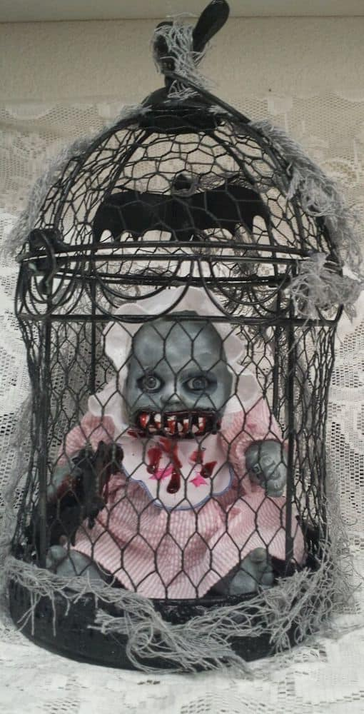 90. THE CREEPY DOLL IN A CAGE