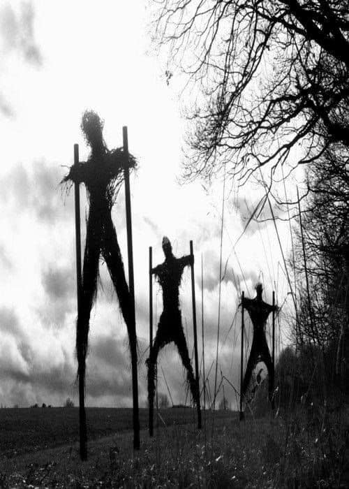 99. GIANT STRAW FIGURES ON STILTS