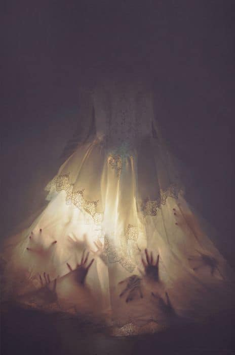 129. CREEPY HANDS IN A WEDDING GOWN