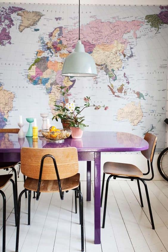 08 bold eclectic dining room with a mpa of the world as a statement decoration