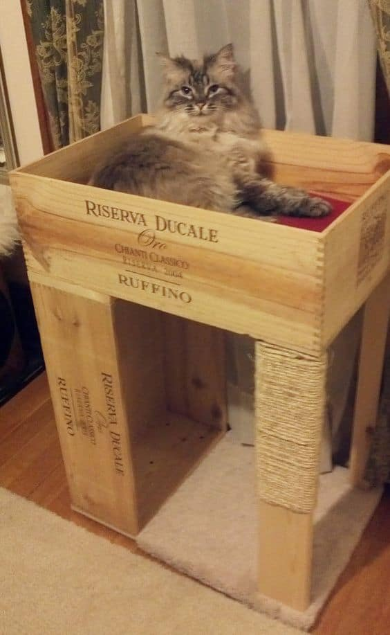 2. CRAFT AN A DIY CAT CONDO OUT OF ORIGINAL WINE CRATES