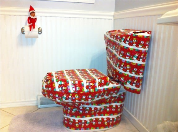 99. Elfie Gift wraps the Commode