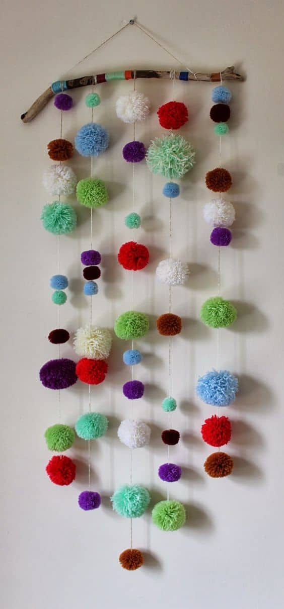 37. POM POM WALL HANGING DOUBLING AS CAT TOY