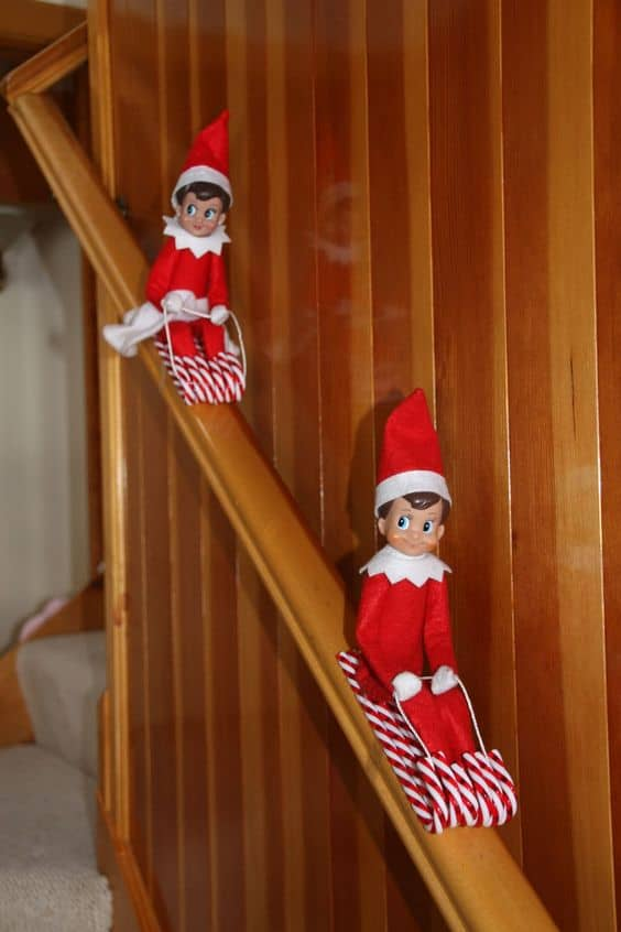 5. Elf on the Shelf Ideas Elfie Cruising on his Candy Cane Sled