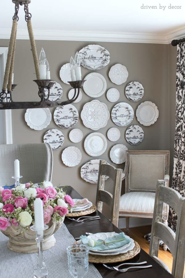 Dining room in neutrals with a statement making plate wall love