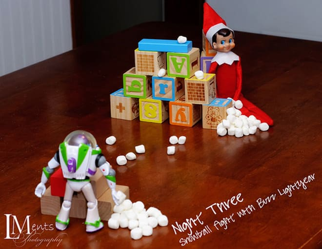 51. Elfie and Buzz Lightyear have a Snowball Fight