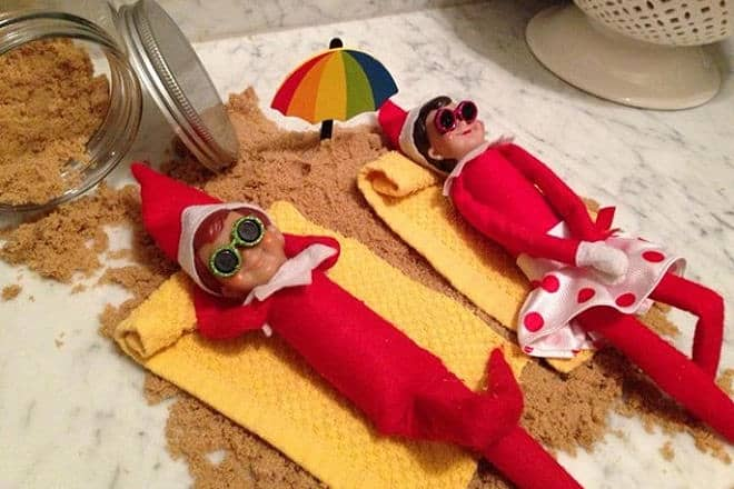 11. Elfie and Elfina Chilling on the Beach Elf on the Shelf Ideas