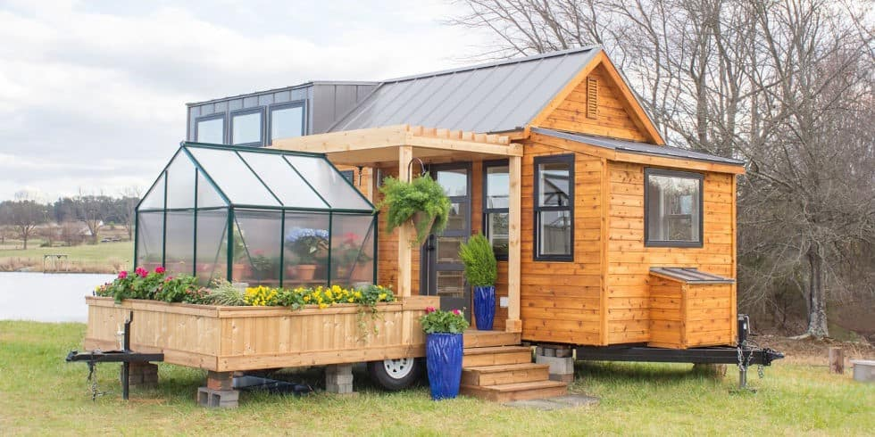 A GREENHOUSE AND A PORCH SWING