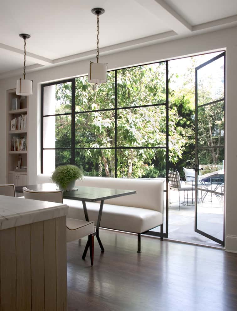 Eating area in a kitchen with floor to ceiling windows