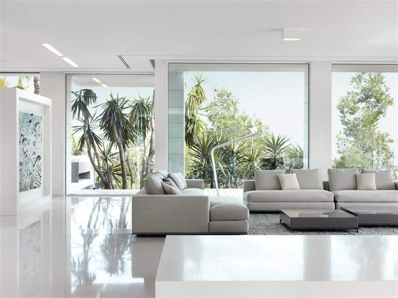 living room with floor to ceiling glass windows