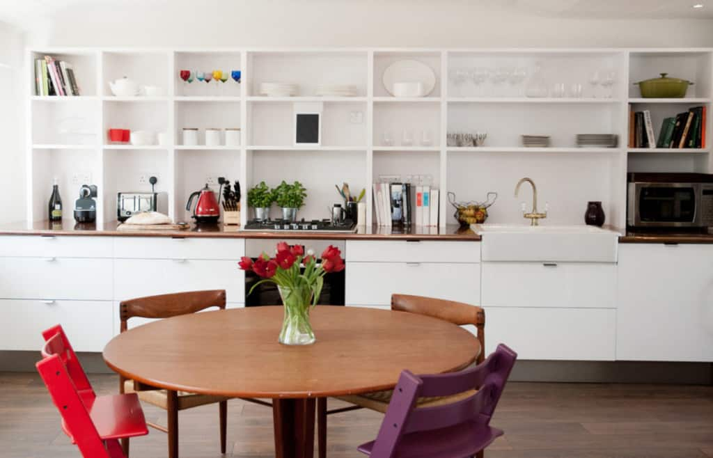 modern kitchen round dining room mismatched chairs galley cabinets open shelving