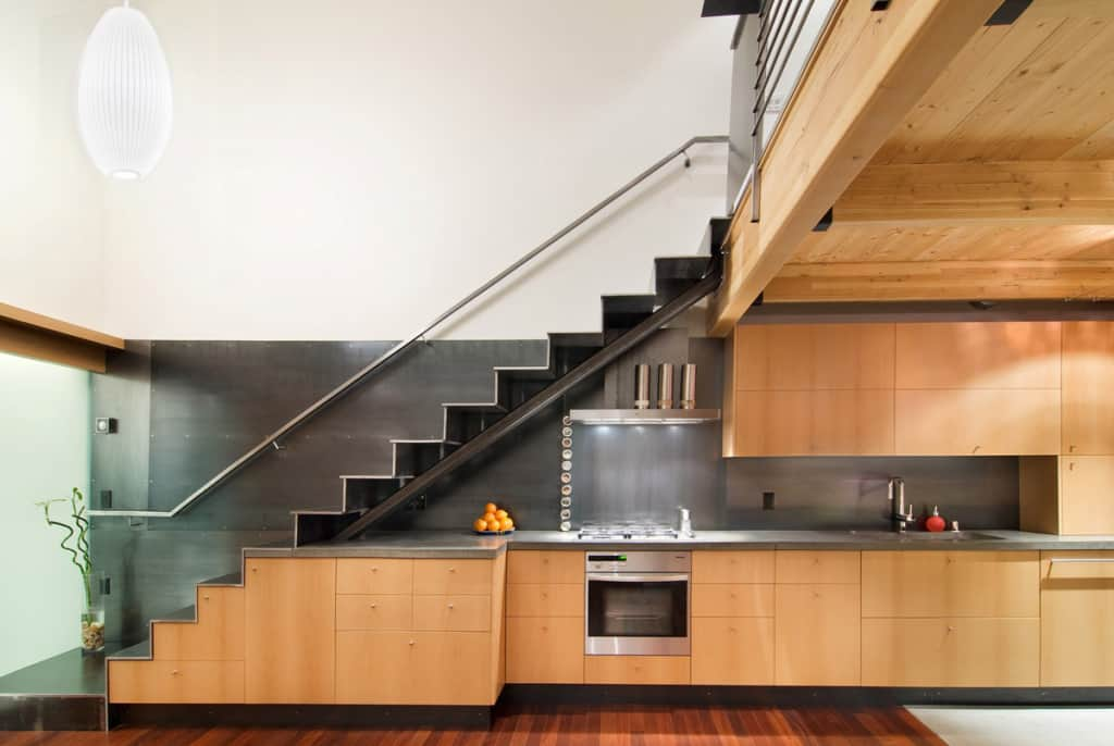 15 smart under the stairs designs that will impress you for Kitchen ideas under stairs