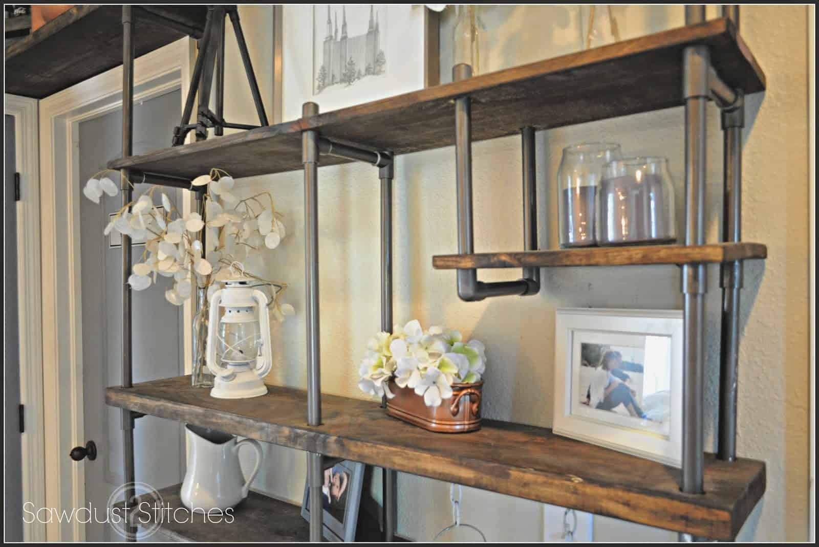 use PVC pipe to build an inexpensive industrial style shelf Sawdust 2 Stitches on Remodelaholic