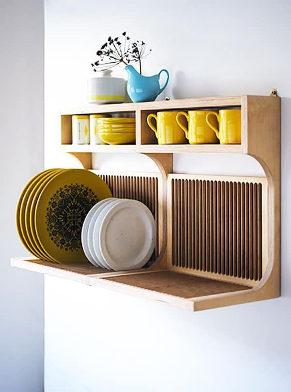 wooden dish drying rack in the wall