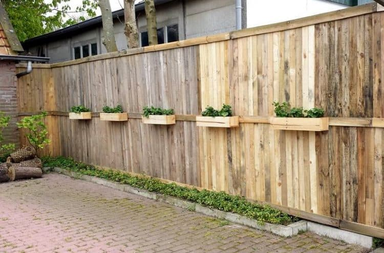 WOODEN FENCE WITH A SMALL PLANTING AREA