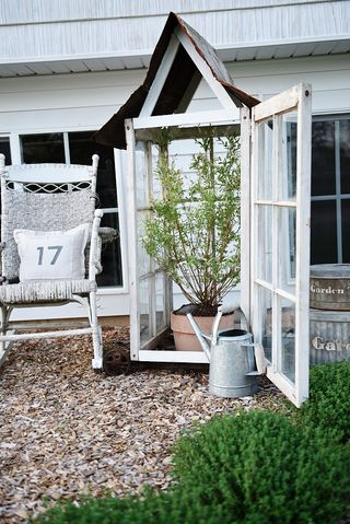 SIMPLE GREENHOUSE MADE USING RECLAIMED WINDOWS