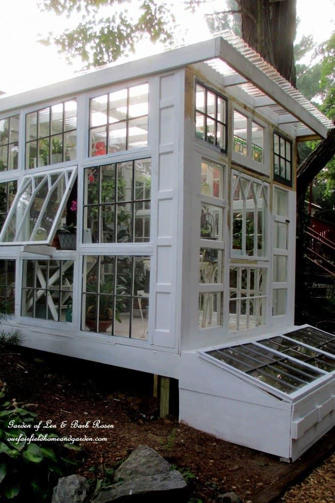 A BEAUTIFUL DIY GREENHOUSE MADE USING REPURPOSED WINDOWS