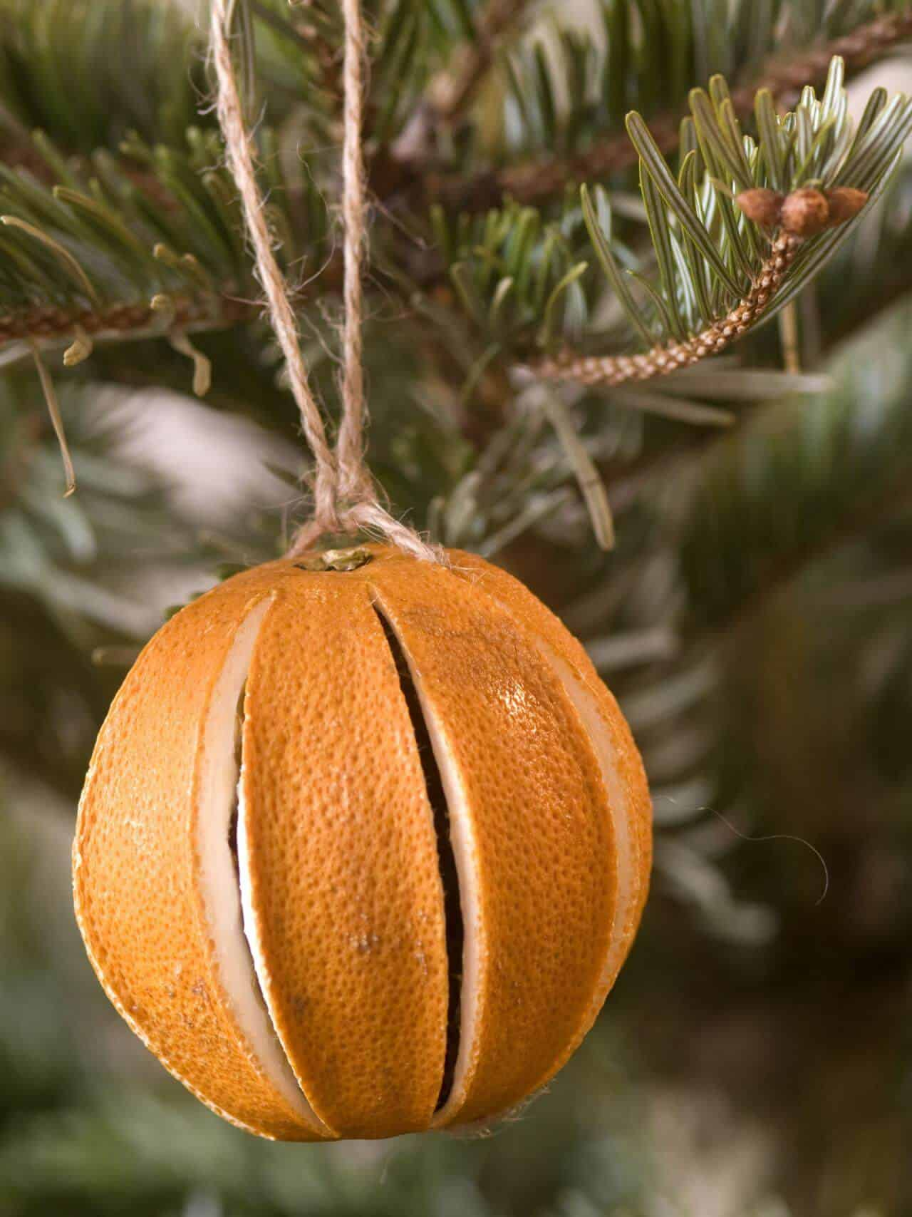 in these crafts you will need to use dried orange and cinnamon sticks in order to make your home look feel and smell more enjoyable - Orange Christmas Decorations