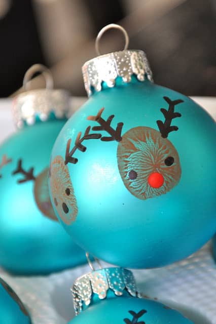 57. Create These Cool Reindeer Thumbprint Ornaments In Just 20 Minutes